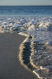 Wave Direction. Sea currents create an interesting pattern as waves come and go from different directions Stock Photo
