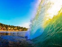 wave för strandbinginsolnedgång Arkivfoto