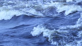 Wave on a fast river stock video footage