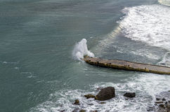 Wave fills a small jetty. Royalty Free Stock Photos