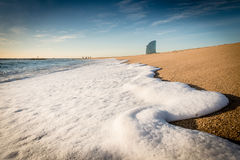Wave foam on the beach. White wave foam on the beach in Barcelona Stock Photography