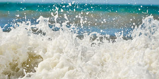 Wave foam. Wave hitting the coast and creating water foam Royalty Free Stock Photo