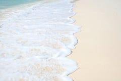 Wave, Foam on Sand Beach Stock Photo