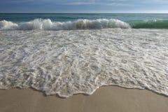Wave foam on white sand beach Stock Photography