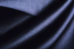 Forms of dark fabric texture. Wave forms of dark polyester fabric texture royalty free stock photography