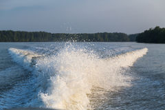 Wave generated by speed boat engine in ocean Stock Photography