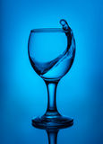 Wave in glass goblet Stock Images