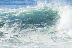 Wave Glassy Water. Ocean wave swell glassy smooth water swell rolling to beach stock photo