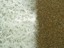 Wave on gravel stones beach Royalty Free Stock Image