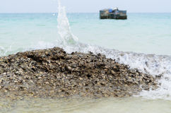 Wave hit on the reef. At samed island, Thailand royalty free stock photography