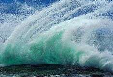 Wave hits rock stock photography