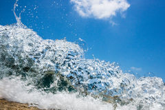 Wave hitting the beach Royalty Free Stock Photography