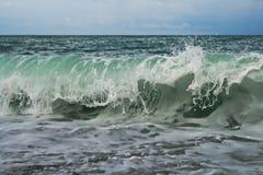 A wave hitting the coast stock image