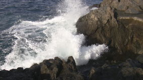 Wave hitting rocks Stock Image