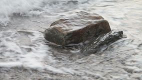 Wave hitting the stone and splash.  stock video