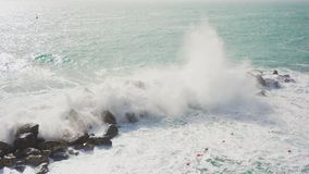 Wave hitting a waterblock in Italy - Riomaggiore stock footage