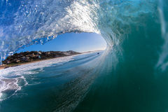 Wave Inside Out Hollow. Large morning wave with size starts pitching or crashing towards the shallow water base . Photo image captured from a water housing with Royalty Free Stock Images