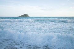 Wave and island Stock Photos