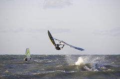 Wave-Jumping windsurfer. A windsurfer jumping the waves at sea Royalty Free Stock Images