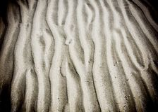Wave line pattern in beach sand Stock Photos