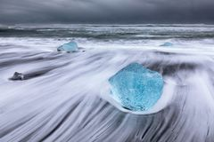 Wave lines in diamond beach, ice blocks in the beach stock photos