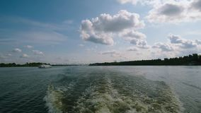 The wave made the boat on the river. A tail of a trace of the riverboat on hydrofoil on a surface of the water on the. The wave made the boat on the river. A stock footage
