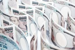 Wave Of Money Yen Banknote On White Background. Business And Finance Concepts, Banknotes Stacked On Each Other In Different Positions Royalty Free Stock Images