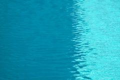 Wave moving by wind on water surface of swimming pool. Wave moving by wind on water surface of the swimming pool stock photo