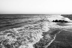 Wave in the ocean. Black and white photo royalty free stock photography