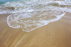 Wave of the ocean on sand beach Royalty Free Stock Photos