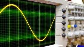 Wave on oscilloscope. Probe arm sinus signal royalty free stock image