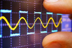 Wave on oscilloscope. Probe arm sinus signal Stock Images