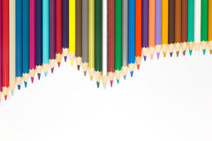 Wave patten of multiple colour wooden pencil on white background Stock Image