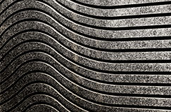 Wave pattern on wall closeup Stock Photos