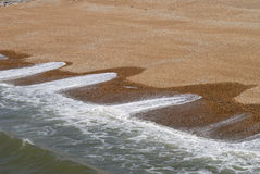 Wave patterns on shingle beach. Patterns on shingle beach caused by action of waves. Brighton. East Sussex. England Stock Photo