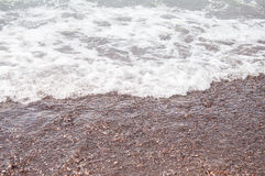sea wave and pebble beach Stock Photography