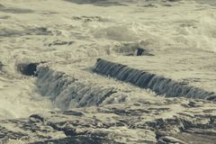 Wave on pier. Stormy wave on old stone pier Royalty Free Stock Photography