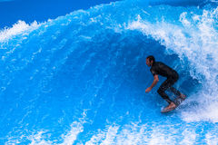Wave Pool Surfer Hollow Curl. Wave pool surfer holding his position inside the hollow pocket of the  fast standing wave for the next competition.Photo image Stock Image