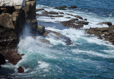 Wave Power against the Rocks of La Jolla, California Stock Photos