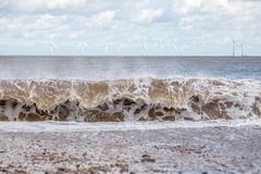 Wave power and force of nature. Renewable energy and sustainable Royalty Free Stock Photo
