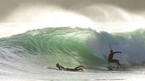 Wave praticante il surfing delle luci Fotografie Stock