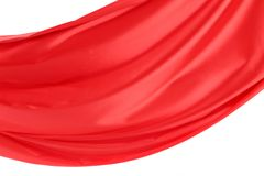 Wave of red satin on a white background. Stock Image