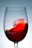 Wave of red wine close up Stock Image