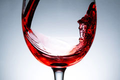 Wave of red wine close up, jet, stream of wine Stock Images