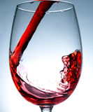 Wave of red wine close up, jet, stream of wine Stock Photos