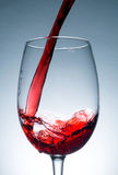 Wave of red wine close up, jet, stream of wine Stock Image