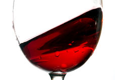 Wave of red wine in glass closeup Stock Images