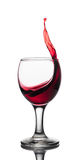 Wave of red wine in a glass Stock Photography