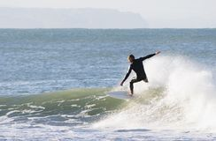 Wave riding. Surfing the break at Haumoana Beach, Hawke's Bay, New Zealand Stock Image