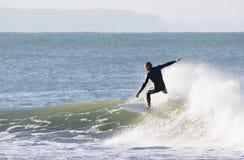 Wave riding Stock Image